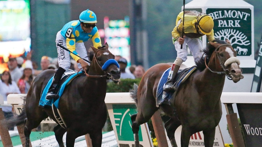June 9, 2012: Union Rags, right, with jockey John Velazquez, holds off Paynter, with jockey Mike Smith, to win the Belmont Stakes horse race at Belmont Park in Elmont, N.Y.