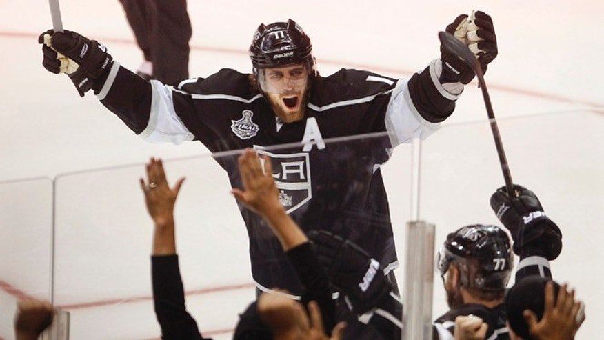 June 11, 2012: Los Angeles Kings center Anze Kopitar celebrates after a teammates' goal against the New Jersey Devils during Game 6 of the Stanley Cup finals.