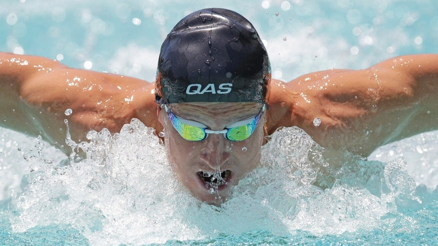 June 1, 2012: Nick D'Arcy, of Australia, competes in a preliminary heat of the 100-meter butterfly at the Santa Clara International Grand Prix swim meet