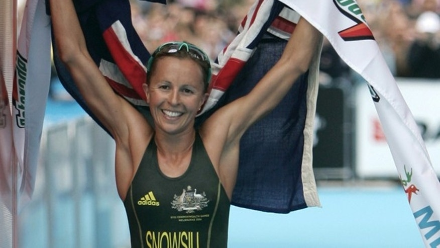 March 18, 2006: In this photo Australia's Emma Snowsill celebrates after winning the women's triathlon at the Commonwealth Games in Melbourne, Australia.