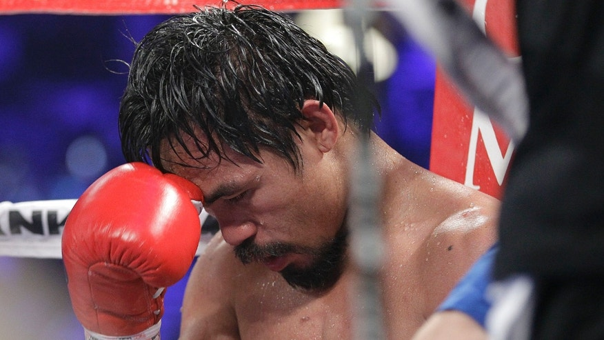 Manny Pacquiao sits in his corner after the 10th round of his bout against Timonthy Bradley. June 9th, 2012. (AP Photo/Julie Jacobson)