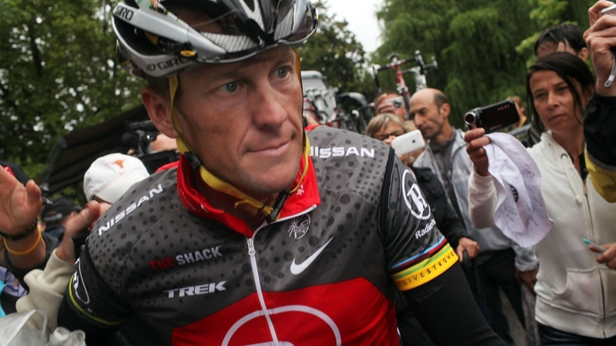 PAU, FRANCE - JULY 22: Lance Armstrong with team RadioShack heads to the start of stage 17 of the Tour de France on July 22, 2010 in Pau, France. Luxembourg's Andy Schleck won the stage while Spaniard Alberto Contador kept the race leaders yellow jersey. The last stage in the Pyrenees, the 174km route from Pau to Col du Tourmalet includes some of the most difficult climbs of the Tour. The iconic bicycle race will include a total of 20 stages and will cover 3,642km before concluding in Paris on July 25.  (Photo by Spencer Platt/Getty Images)