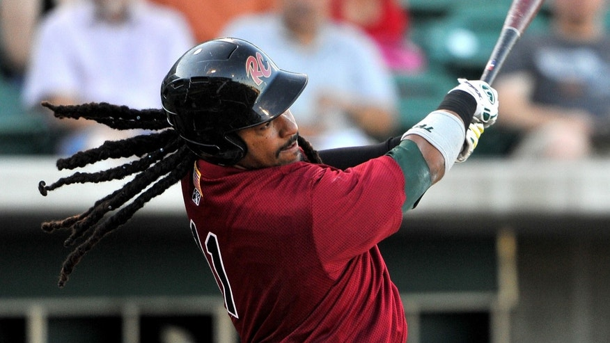 June 11, 2012: Sacramento River Cats' Manny Ramirez's  locs fly as he follows through on a first inning single against the Fresno Grizzlies during their Triple-A baseball game in Fresno, Calif.