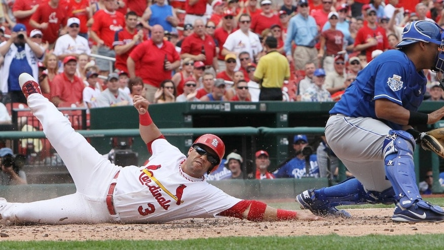 June 16, 2012:  St. Louis Cardinals' Carlos Beltran scores on a hit by Matt Holliday as Kansas City Royals catcher Bryan Pena fields the throw in second inning action of the baseball game in St. Louis