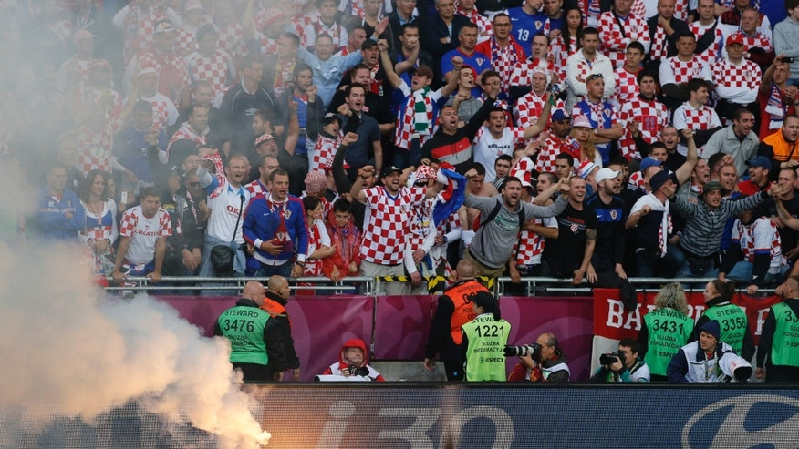 June 14, 2012: This file photo shows Croatian fans cheering after a flare was thrown onto the pitch during the Euro 2012 soccer championship Group C match between Italy and Croatia in Poznan, Poland.