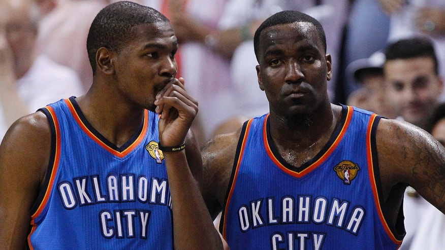 Oklahoma City Thunder small forward Kevin Durant (35) and center Kendrick Perkins (5) react against the Miami Heat during the second half at Game 3 of the NBA Finals basketball series, Sunday, June 17, 2012, in Miami. Miami won 91-85. (AP Photo/Lynne Sladky)