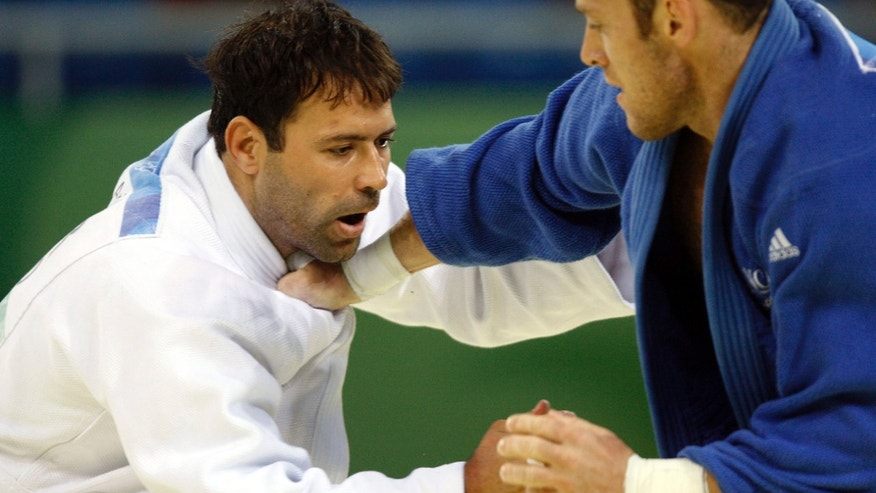 Aug. 14, 2008: Israel's Arik Zeevi, white, and France's Frederic Demontfaucon compete at the men's judo -100kg half heavyweight division preliminaries at the Beijing 2008 Olympics in Beijing.