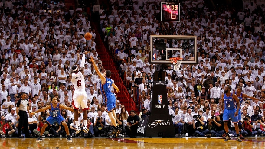 MIAMI, FL - JUNE 19:  LeBron James #6 of the Miami Heat attempts a shot over Nick Collison #4 of the Oklahoma City Thunder in the second half of Game Four of the 2012 NBA Finals on June 19, 2012 at American Airlines Arena in Miami, Florida. NOTE TO USER: User expressly acknowledges and agrees that, by downloading and or using this photograph, User is consenting to the terms and conditions of the Getty Images License Agreement.  (Photo by Mike Ehrmann/Getty Images)