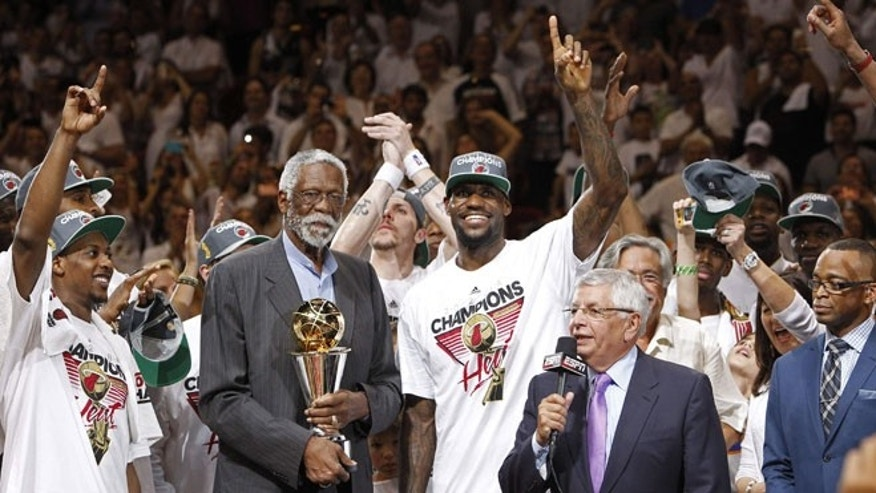 June 22, 2012: NBA legend Bill Russell presents the most valuable player award to the Miami Heat's LeBron James (6) after Game 5 of the NBA finals basketball series against the Oklahoma City Thunder. The Heat won 121-106 to become the 2012 NBA Champions.