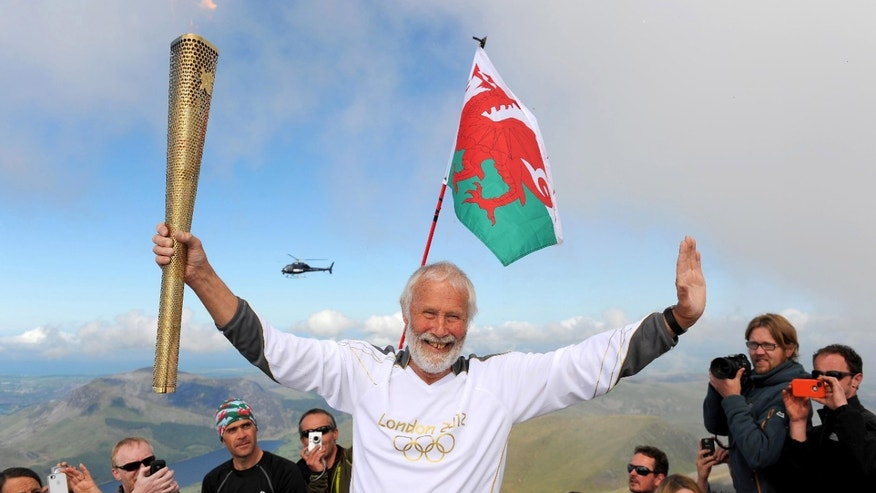 May 29, 2012: In this file photo made available by LOCOG, Sir Chris Bonington holds the Olympic Flame on the top of Mount Snowdon in Wales during the Olympic Torch Relay.