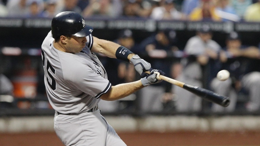 New York Yankees' Mark Teixeira hits a single during the first inning of an interleague baseball game against the New York Mets, Friday, June 22, 2012, in New York.  (AP Photo/Frank Franklin II)