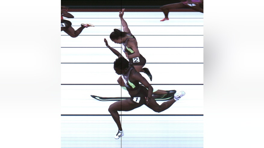 June 23, 2012:  Allyson Felix and Jeneba Tarmoh, in foreground, finished in a dead heat for the last U.S. spot in the 100 to the London Games, each leaning across the finish line in 11.068 seconds, during the U.S. Olympic Track and Field Trials in Eugene, Ore.