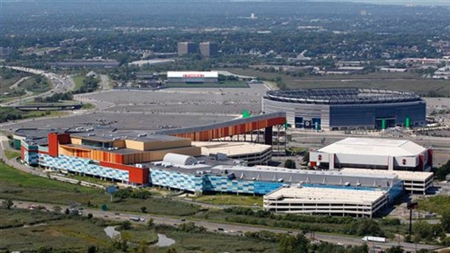 This Sept. 1, 2011 file photo shows MetLife Stadium, rear right, and the Izod Center, middle right, behind American Dream, the unfinished oddly patterned shopping and entertainment complex, in East Rutherford, N.J.