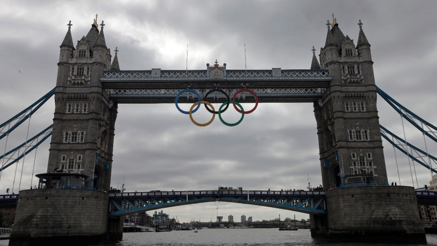 June 27, 2012: The iconic Tower Bridge in London has been adorned with the Olympic rings in an effort to get the city read for next month's games. (AP Photo)