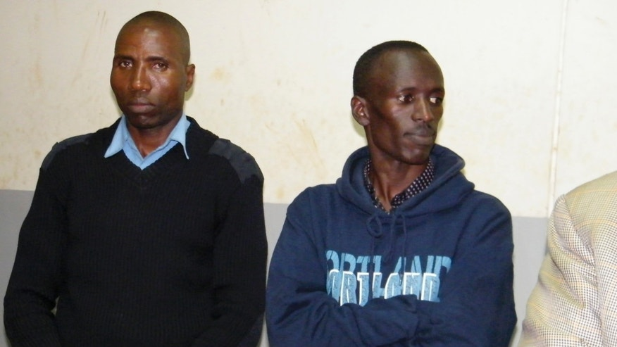 June 28, 2012: World 3000m steeplechase champion and Olympic athlete Ezekiel Kemboi, right, accompanied by a police officer, left, attends a court in Eldoret, Kenya, where he was charged with assault after a woman claimed he stabbed her.