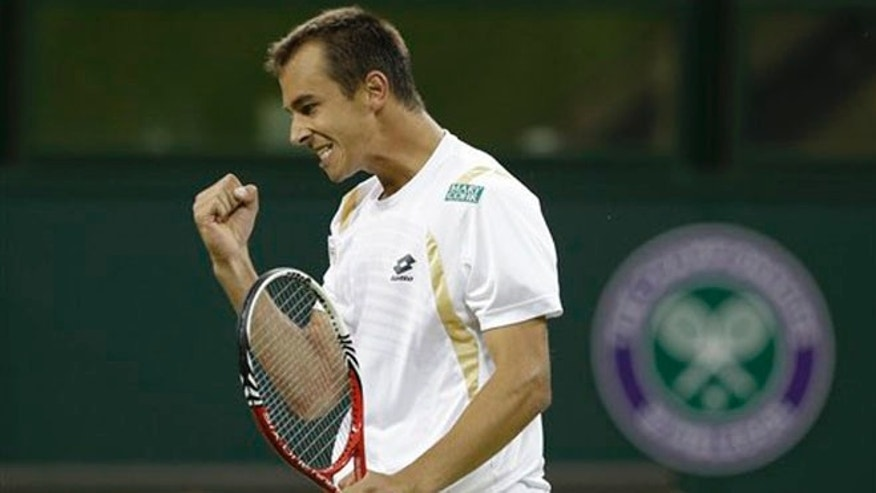 June 28, 2012: Lukas Rosol of the Czech Republic reacts during a second round men's singles match against Rafael Nadal of Spain at the All England Lawn Tennis Championships at Wimbledon, England.