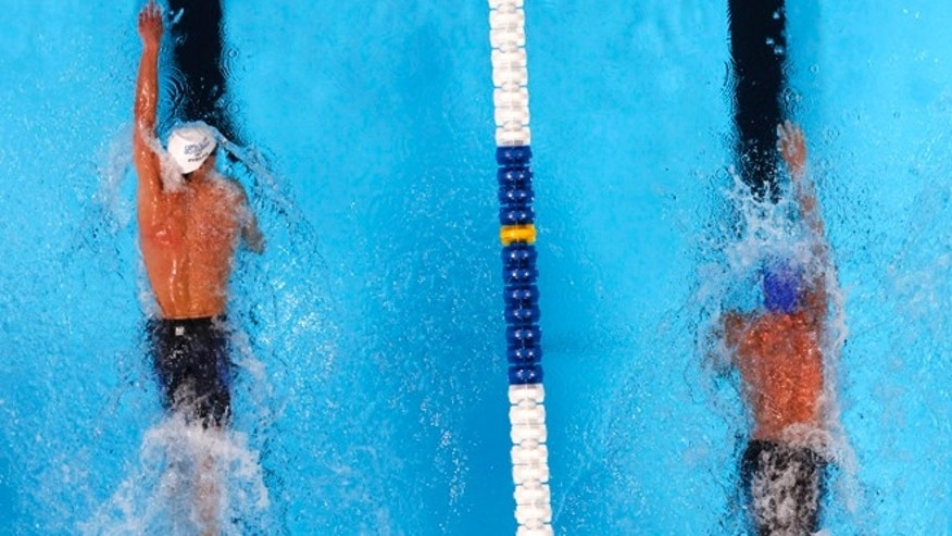 June 27, 2012: Michael Phelps, left, and Ryan Lochte compete in the men's 200-meter freestyle final at the U.S. Olympic swimming trials,  in Omaha, Neb.