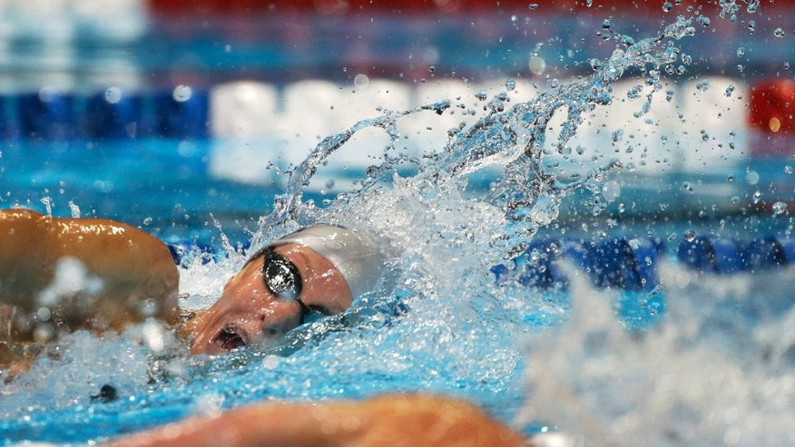June 29, 2012: Dana Vollmer swims in the women's 100-meter freestyle preliminaries at the U.S. Olympic swimming trials in Omaha, Neb.