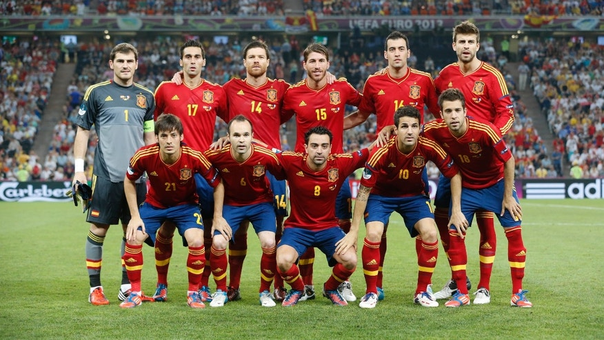 Standing top left to right are Spain goalkeeper Iker Casillas, Spain's Alvaro Arbeloa, Spain's Xabi Alonso, Spain's Sergio Ramos, Spain's Sergio Busquets,  Spain's Gerard Pique and bottom left to right are Spain's David Silva, Spain's Andres Iniesta, Spain's Xavi Hernandez, Spain's Cesc Fabregas and Spain's Jordi Alba before the start of the Euro 2012 soccer championship quarterfinal match between Spain and France in Donetsk, Ukraine, Saturday, June 23, 2012. (AP Photo/Matthias Schrader)