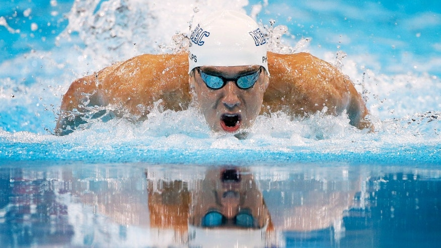 Michael Phelps, above doing the 100m butterfly at the 2012 Olympic Trials, has opted to drop his 200m freestyle event in London, making him eligible to win seven medals. (AP)