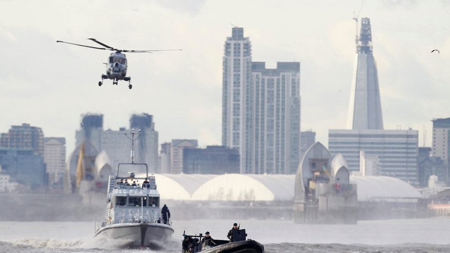 Jan 19. 2012: In this file photo security forces take part during in a combined British police and British Royal Marines security exercise for the London 2012 Olympic Games on the River Thames in London.