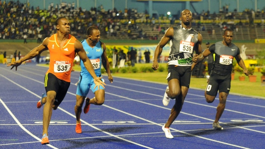 June 29, 2012: World champion Yohan Blake, left, celebrates after crossing the finish line ahead of current world-record holder Usain Bolt, second from right, Nesta Carter, right, and Michael Frater to win the 100m final at Jamaica's Olympic trials in Kingston, Jamaica.