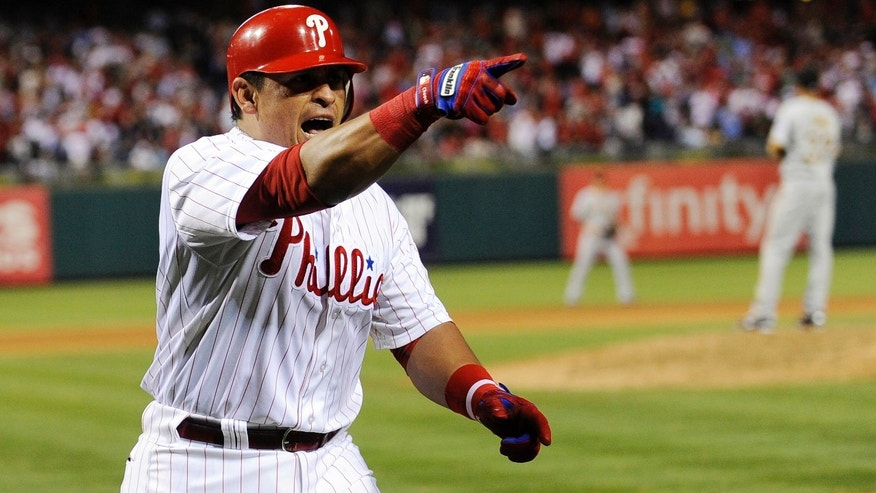 Philadelphia Phillies' Carlos Ruiz points to his team after he hit a home run against the Pittsburgh Pirates in the eighth inning of a baseball game, Tuesday, June 26, 2012, in Philadelphia. The Phillies won 5-4. (AP Photo/Michael Perez)