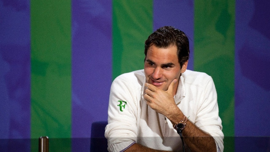 July 8, 2012: Roger Federer speaks during a news conference after he won the men's singles final against Andy Murray of Britain at the All England Lawn Tennis Championships, Wimbledon, England.