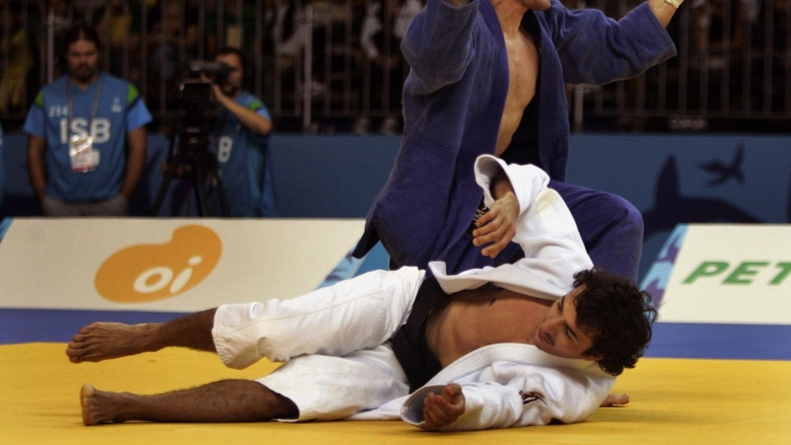 July 21, 2007: In this file photo U.S. Travis Stevens, top, celebrates after beating Colombia's Mario Valles during their under 81kg judo final match at the Pan American Games in Rio de Janeiro.