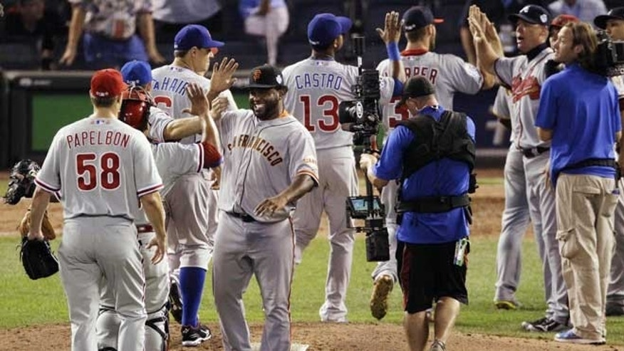 July 10, 2012: National League's Pablo Sandoval, of the San Francisco Giants, right, celebrates with teammates after their 8-0 win over the American League in the MLB All-Star baseball game in Kansas City, Mo.