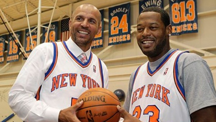 July 12, 2012: Jason Kidd, left, and Marcus Camby pose for a photograph following a news conference to introduce the New York Knicks newest additions at the team's NBA basketball training facility in Tarrytown, N.Y.