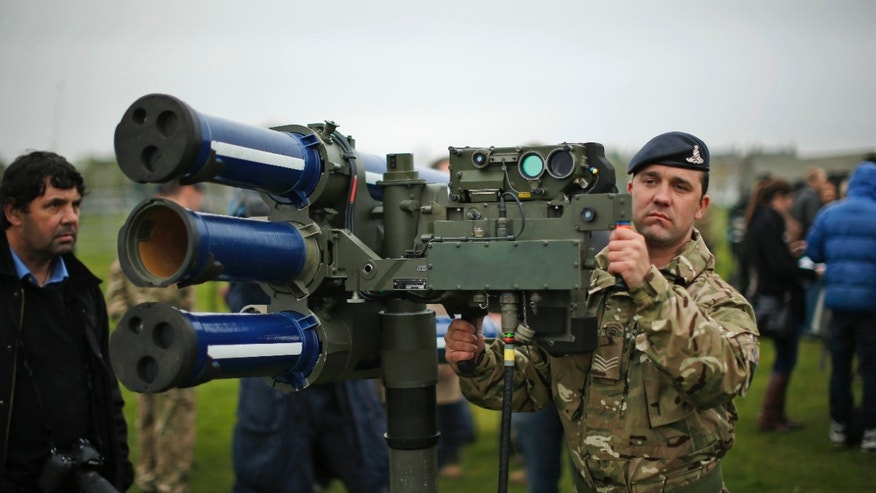 May 3, 2012: In this file photo, Sergeant Craig from Britain's Royal Artillery regiment holds a high-velocity missile, or HVM, lightweight multiple launcher during a media event ahead of a training exercise designed to test military procedures prior to the Olympic period in Blackheath, London.