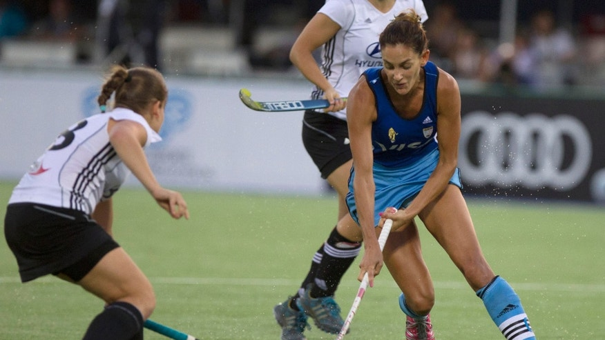 Jan. 29, 2012: In this file photo, Argentina's Luciana Aymar, right, is challenged by Germany's Lisa Hahn during their Women's Champions Trophy field hockey match in Rosario, Argentina.
