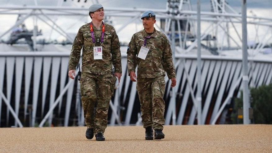 July 15, 2012: British military personnel walk away from the Olympic Stadium as preparations continue for the 2012 Summer Olympics in London.
