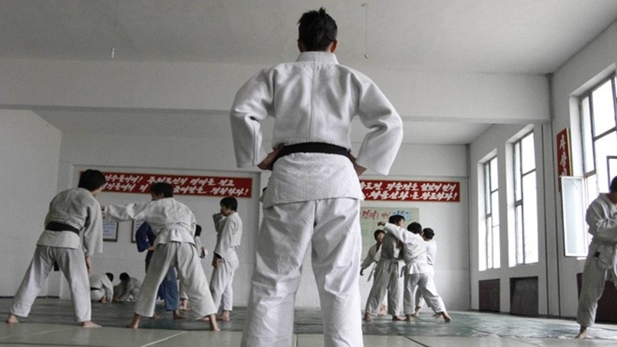 June 22, 2012: In this photo, North Korean judo coach Kye Sun Hui, center, trains players in Pyongyang, North Korea.
