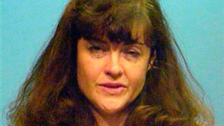This booking photo provided by the Chicago Police Department shows Kathleen Kearney, 44, of Canton, Mass.
