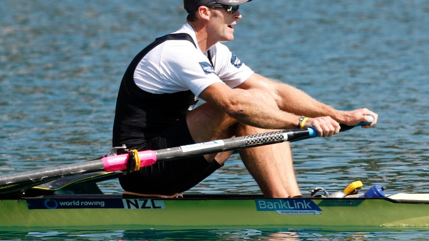 Sept. 2, 2011: In this file photo Mahe Drysdale of New Zealand reaches the finish area of the Men's Single Sculls semifinal event at the Rowing World Championships in Bled, Slovenia.