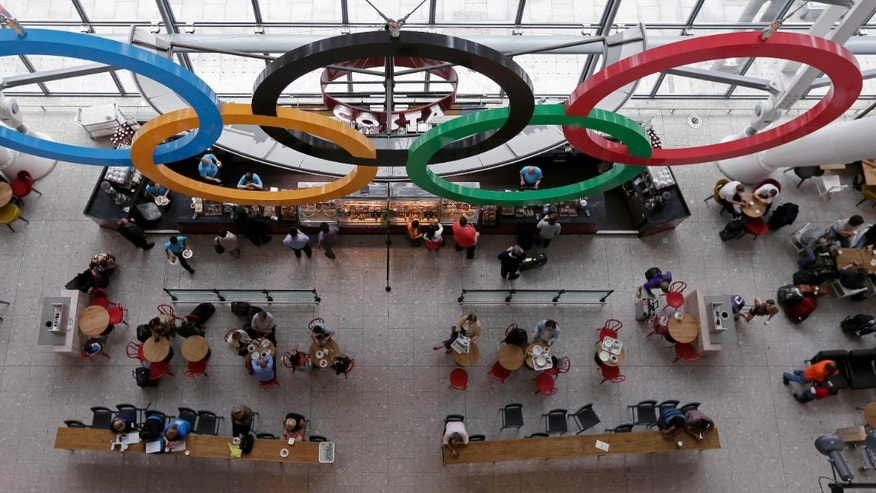 July 17, 2012: Patrons dine below the Olympic Rings at a coffee shot at Heathrow Airport, as London prepares for the 2012 Summer Olympics.