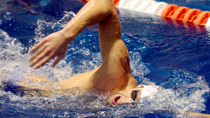 July 12: 2012: U.S. Olympic swim team member Michael Phelps practices at the University of Tennessee's Allan Jones Aquatic Center in Knoxville, Tenn.