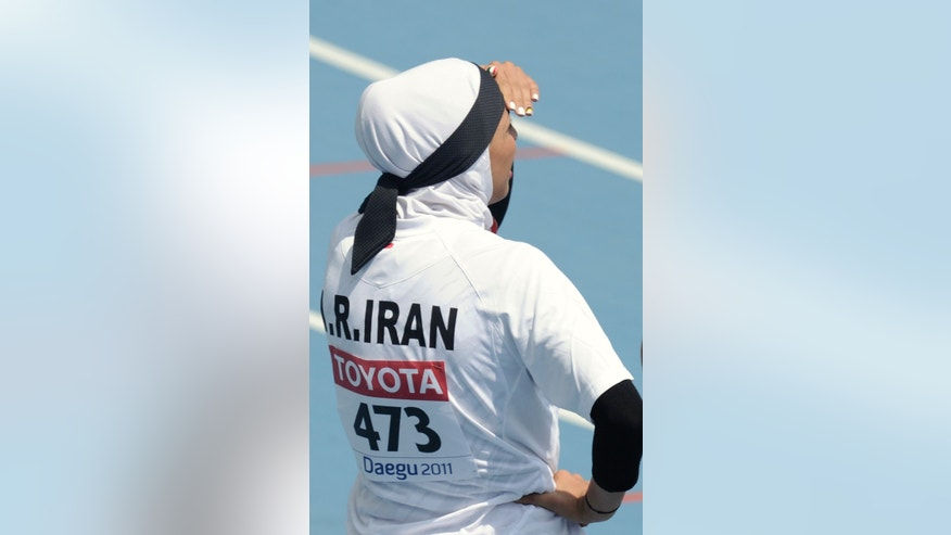 FILE - The Sept. 1, 2011 file photo shows Iran's Maryam Toosi  as she looks up at the timing board after competing in a Women's 200m qualification heat at the World Athletics Championships in Daegu, South Korea, With the London Games fast approaching and the Islamic holy month of Ramadan already here, Muslim athletes are now faced with a dilemma of  Olympian proportions. (AP Photo/Martin Meissner, file)