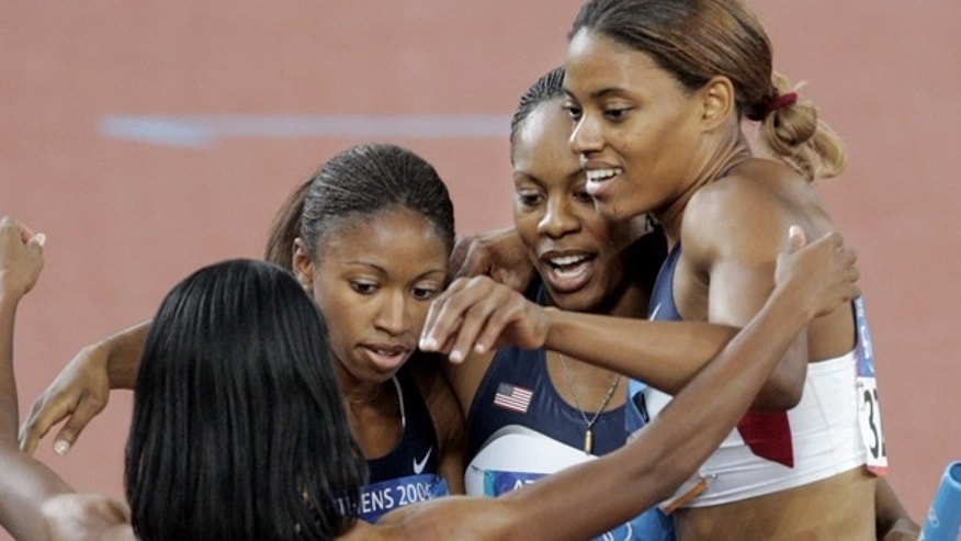 Aug. 27, 2004: In this file photo, the United States 4x400 meter relay team of Monique Henderson (3278), Moushaumi Robinson, back left, Sanya Richards, second right, and Crystal Cox, right, react after running and winning their heat in the first round at the Olympic Stadium in the 2004 Olympic Games in Athens.