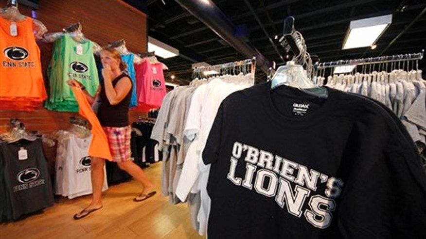 July 23, 2012: T-shirts on display supporting new head coach of the Penn State football team, Bill O' Brien, are on display in a downtown State College, Pa., shop.