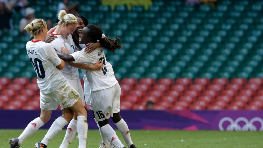 July 25, 2012: Britain's Stephanie Houghton, center, celebrates after scoring with her teammates from left, Kelly Smith, and Eniola Aluko, during the women's group E soccer match between Great Britain and New Zealand, at the Millennium stadium in Cardiff, Wales, at the 2012 London Summer Olympics.