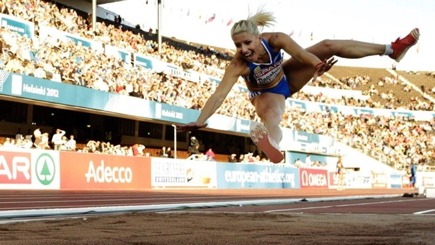 June 29, 2012: FILE- Greece's Voula Papachristou soars through the air in the Women's Triple Jump final at the European Athletics Championships in Helsinki, Finland.
