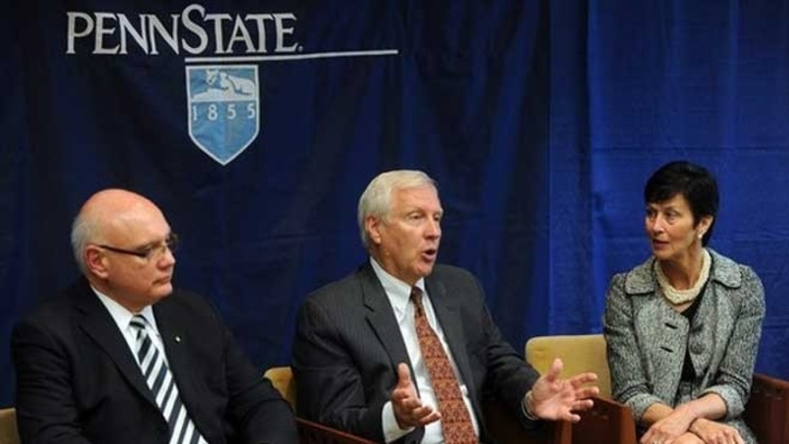 July 23, 2012: Penn State president Rodney Erickson, center, talks during an interview with the Centre Daily Times in State College, Pa.