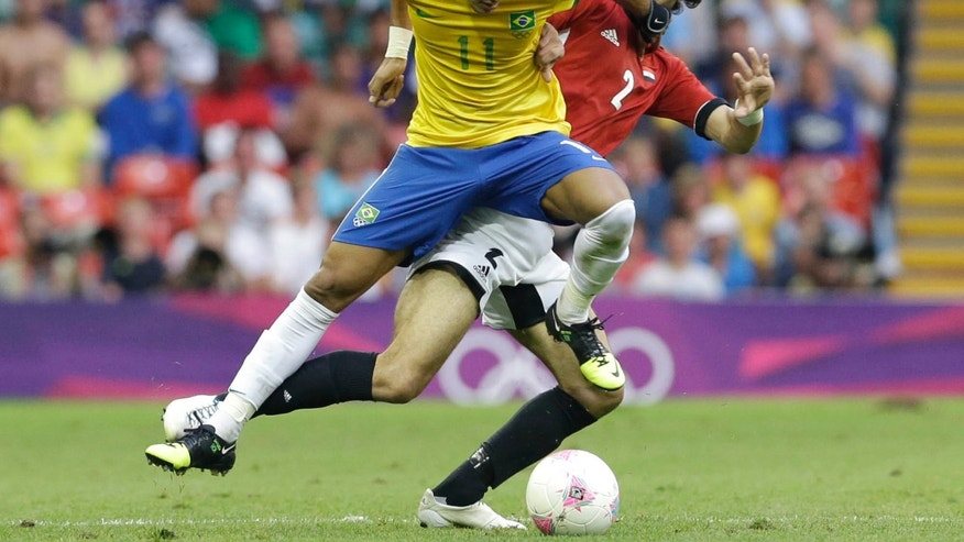 July 26, 2012: Brazil's Neymar, left, challenges for the ball with Egypt's Mahmoud Alaa Eldin during the men's group C soccer match between Brazil and Egypt, at the Millennium stadium in Cardiff, Wales, at the 2012 London Summer Olympics.