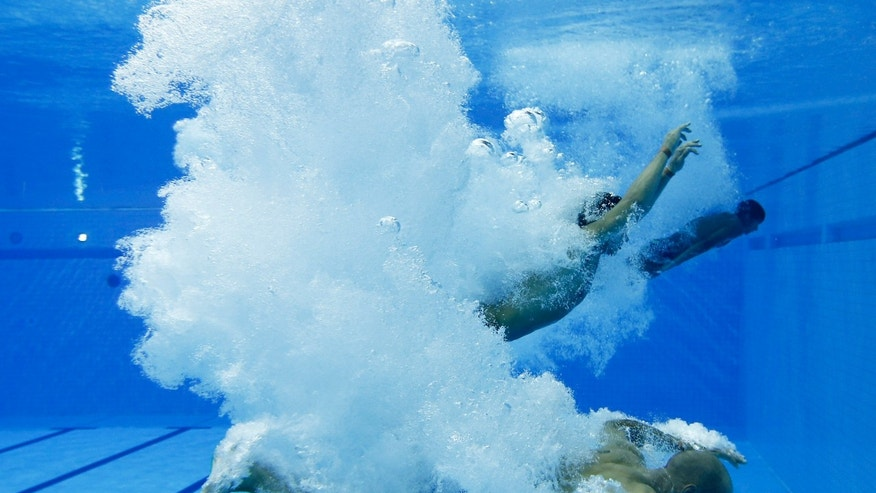 July 26, 2012: A diver plunges in the pool during a practice session at the Aquatics Center at the Olympic Park ahead of the 2012 Summer Olympics, Thursday in London.