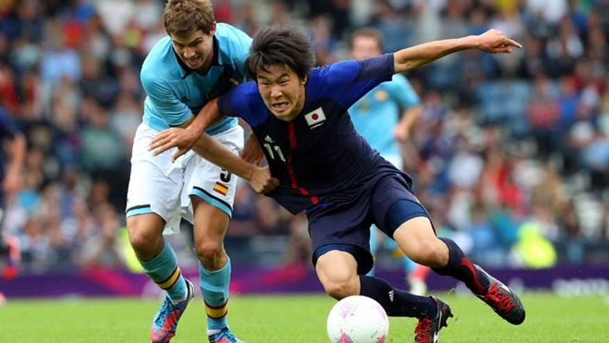 GLASGOW, SCOTLAND - JULY 26 : Kensuke Nagai of Japan clashes with Inigo Martinez of Spain during the Men's Football first round Group D Match of the London 2012 Olympic Games between Spain and Japan at Hampden Park on July 26, 2012 in Glasgow, Scotland.  (Photo by Stanley Chou/Getty Images)
