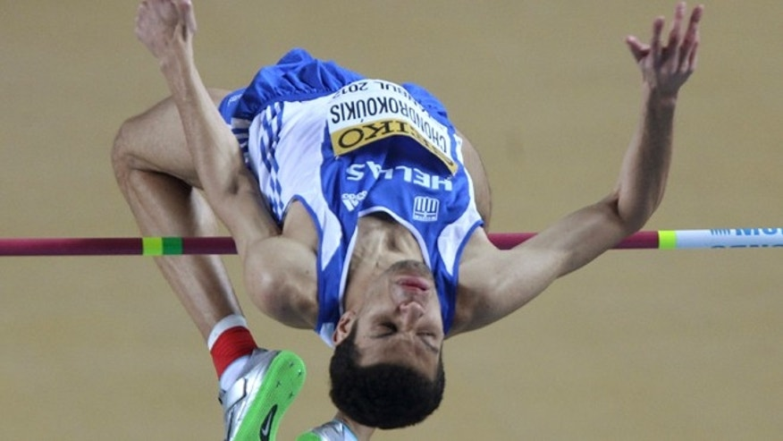 March 11, 2012: This file photo shows Greece's gold medal winner Dimitrios Chondrokoukis clearing the bar during Men's High Jump final at the World Indoor Athletics Championships in Istanbul, Turkey.