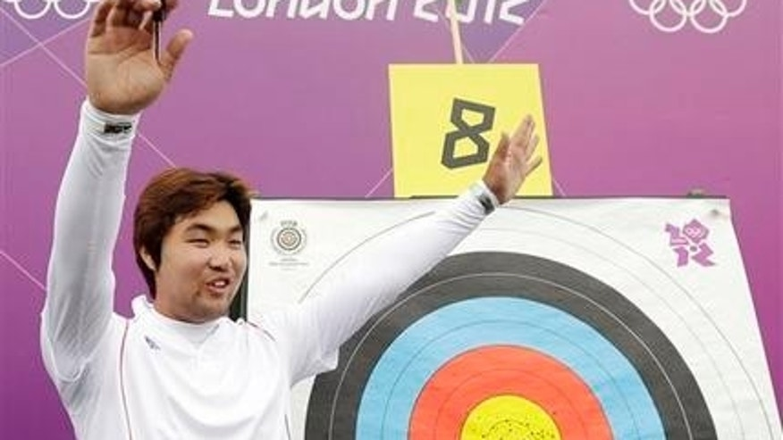July 27, 2012: South Korea's Im Dong-hyun celebrates his world record during an individual ranking round at the 2012 Summer Olympics.